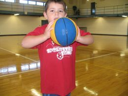 Teach fun passing using the ears of the basketball and creating chicken wings with elbows.  Bawk!  Bawk!