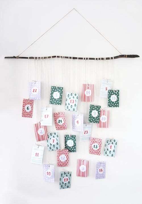 Make your own DIY advent calendar for Christmas with this cute and free printable, designed by http://thelovelydrawer.com - USQ
