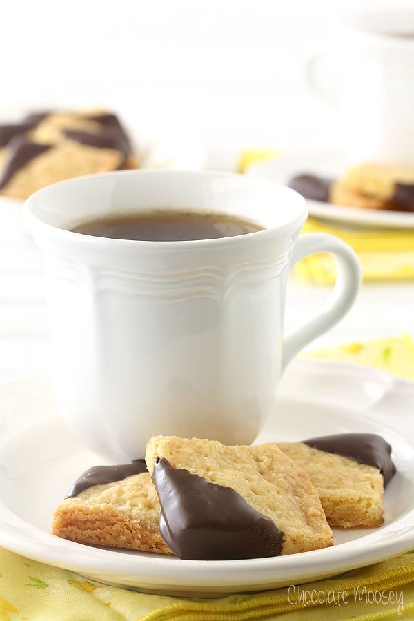 Melt-in-your-mouth Chocolate-Dipped Orange Shortbread Cookies will make you feel like royalty.