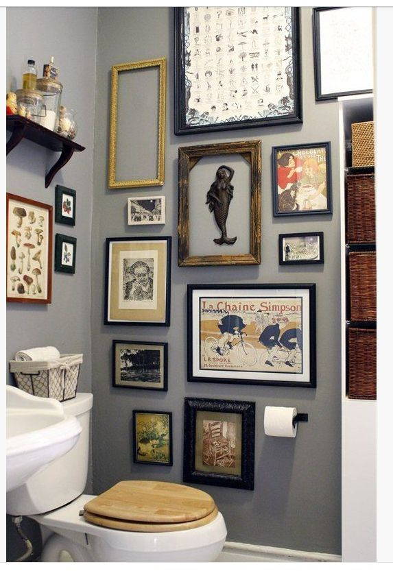 Love the bathroom decor. Old ornate frames with interesting old pictures.