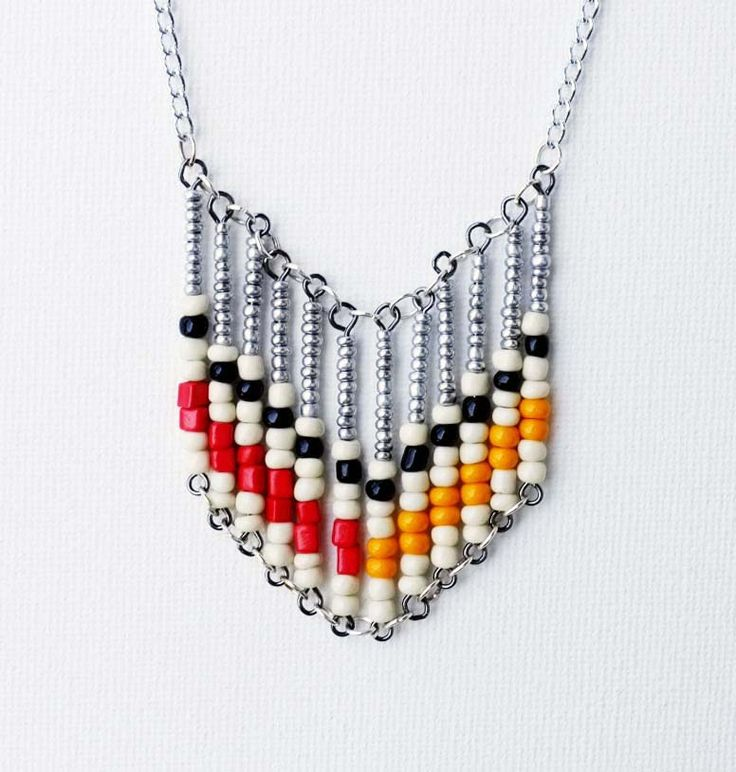 ABACUS is a new range of limited edition contemporary jewellery handmade by Eklectic Mix. Orange Red Black Cream Beaded Tribal Geometric Necklace.• Geometric lines and obtuse layouts are the inspiration for my latest creations.• Suspended from a silver chain hangs vertical rows of silver, orange, cream and black acrylic beads.• Piece measures 60 cms end to end, decorative area measures 7.5cm x 5cms. Silver chain and acrylic beads.• This is a one off handmade piece....