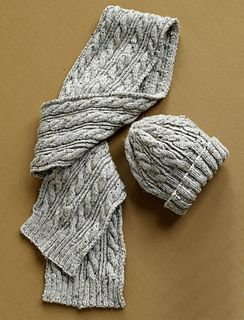 This matching hat and scarf set features classic cables, making it perfect for any man or woman. (Lion Brand Yarn)