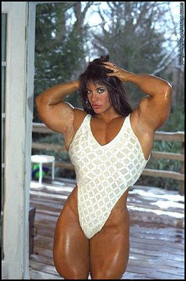 Brunette bodybuilder front body flex   Ripped women