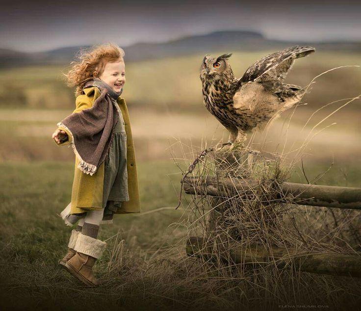 Sweet ginger haired girl and owl, preparing for flight
