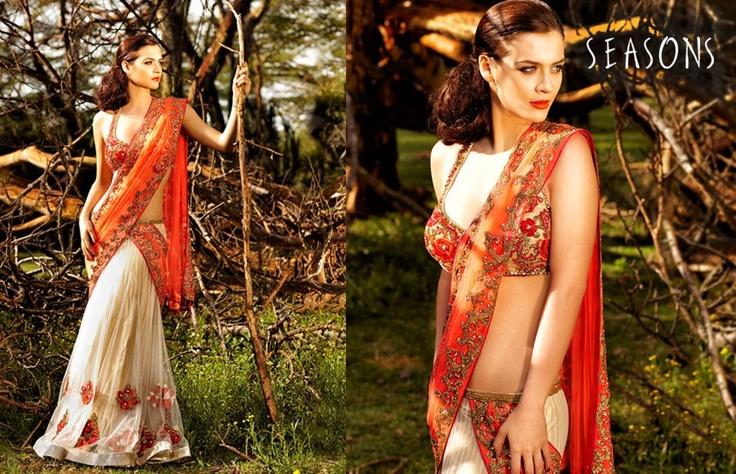 Orange. It's so beautiful I love there collection ♥  Hindu / indian bride Wear saree, lehenga, choli from seasonsindia. the model is Neha Dalvi or maria sokolovski
