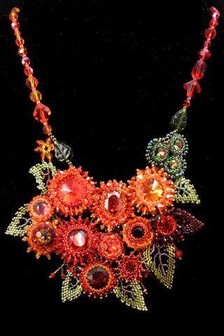 Handmade necklace made of five dark blue handmade glass yo-yo beads surrounded…