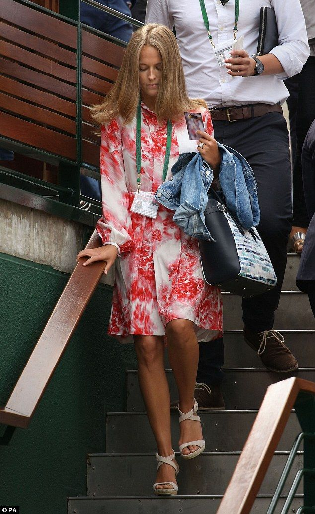Kim Murray walks to centre court during day seven of the Wimbledon Championships at the Al...