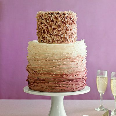 Ombre Wedding Cake | Incorporate details from your dress and bouquet into the cake, as Washington D.C. artist and pastry chef Maggie Austin did here. Tiny hydrangea blossoms sit atop layers of buttercream icing, reminiscent of a ruffled bridal gown.: