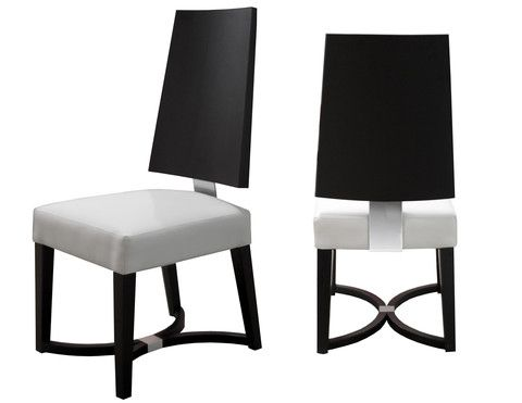 The Devo Chair is a beautiful modern tall seat back dining chair. This dining chair epitomizes contemporary style with its blend of dark wood, bonded leather and chrome accent. This dining chair rests atop a striking base featuring two adjoining arcs with a metal detail.