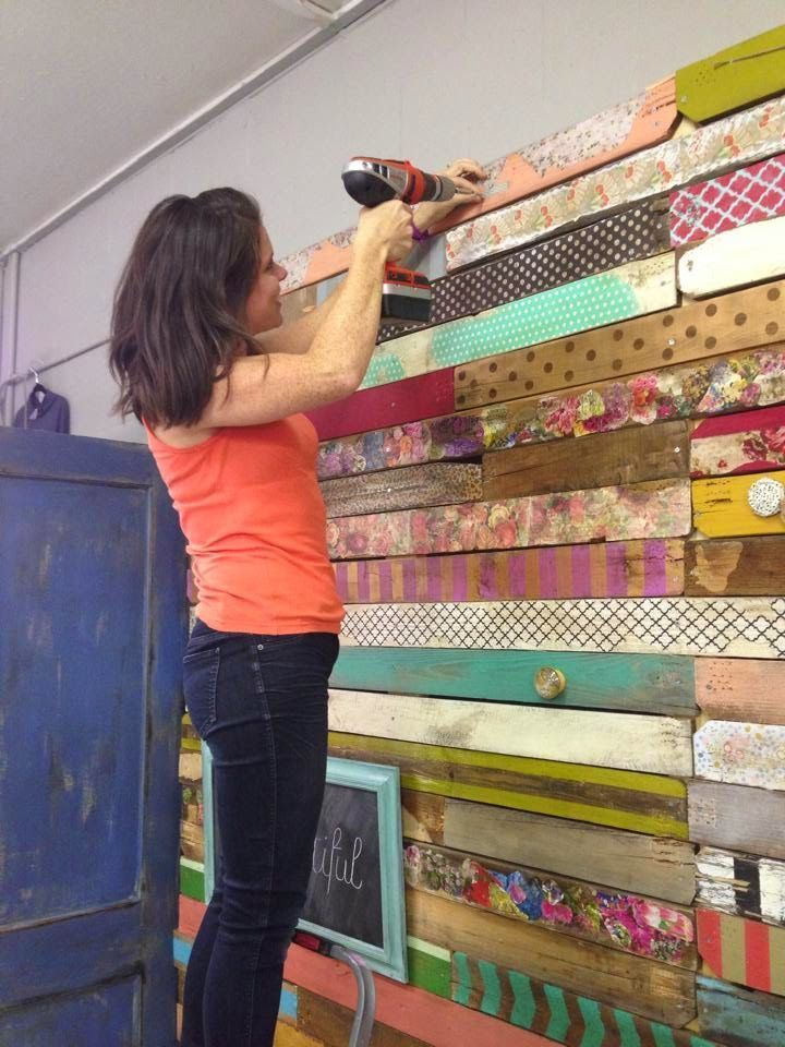 "Vintage Show Off: A Fabulous Pallet Wall ""We painted and stained some, decoupaged with tissue paper, scrap book paper, napkins, fabric, magazine clippings and wrapping paper. A few are embellished with knobs, hooks and fabric flowers."""