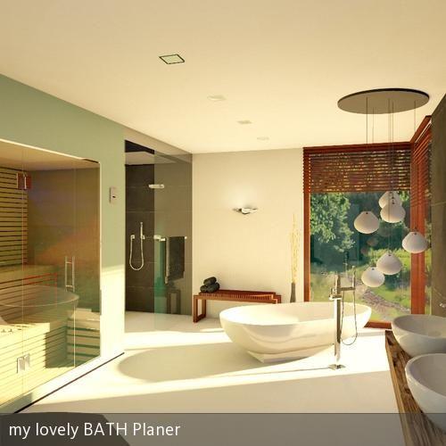 Badezimmer mit freistehender Badewanne und Ausblick.