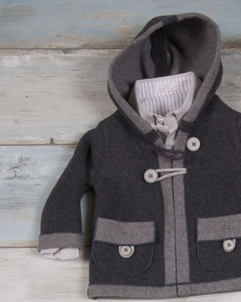 Winter coat with hood of thick double colored straw in grey shades.