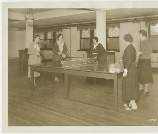 Glee Club students from New Jersey playing table tennis in the recreational room in Student Alumnae Hall, after a music rehearsal; l-r: Rosalie Peppler 33, Martha Town 32, Winifred Greene 32, Doris Caldwell 32, and Elizabeth Brown 34 :: Archives & Special Collections Digital Images :: 1931