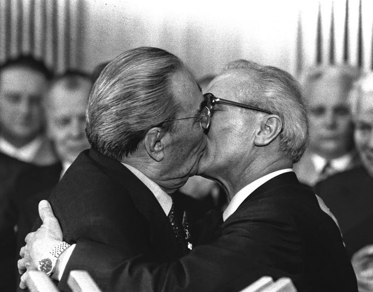 """Berlin, East Germany, Oct. 4, 1979 – Soviet President Leonid Brezhnev and East German leader Erich Honecker change kisses after Brezhnev was honored with the title """"Hero of the German Democratic Republik"""" and the """"Karl Marx Medal"""". Brezhnev participates in the celebrations marking the 30th anniversary of the East German State`s foundation. (AP Photo/Helmuth Lohmann/stf)"""