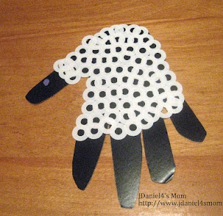 Handprint Lamb with Hole Reenforcers - good for nursery rhymes maybe with cereal too?