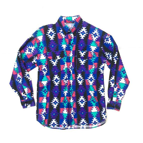 Vintage 1990s unisex multicoloured geometric southwest print cotton shirt with front patch pockets and button down collar  DESCRIPTION: Colourful nineties unisex southwest print cotton button down shirt with chest pockets. This great shirt features an all over southwest style print in turquoise, pink, purple, blue and black with hints of white. The sleeves are long and join to a single button cuff with pleats and a placket at wrist. There is a shaped hem and a 6 button front. Get your 90s…