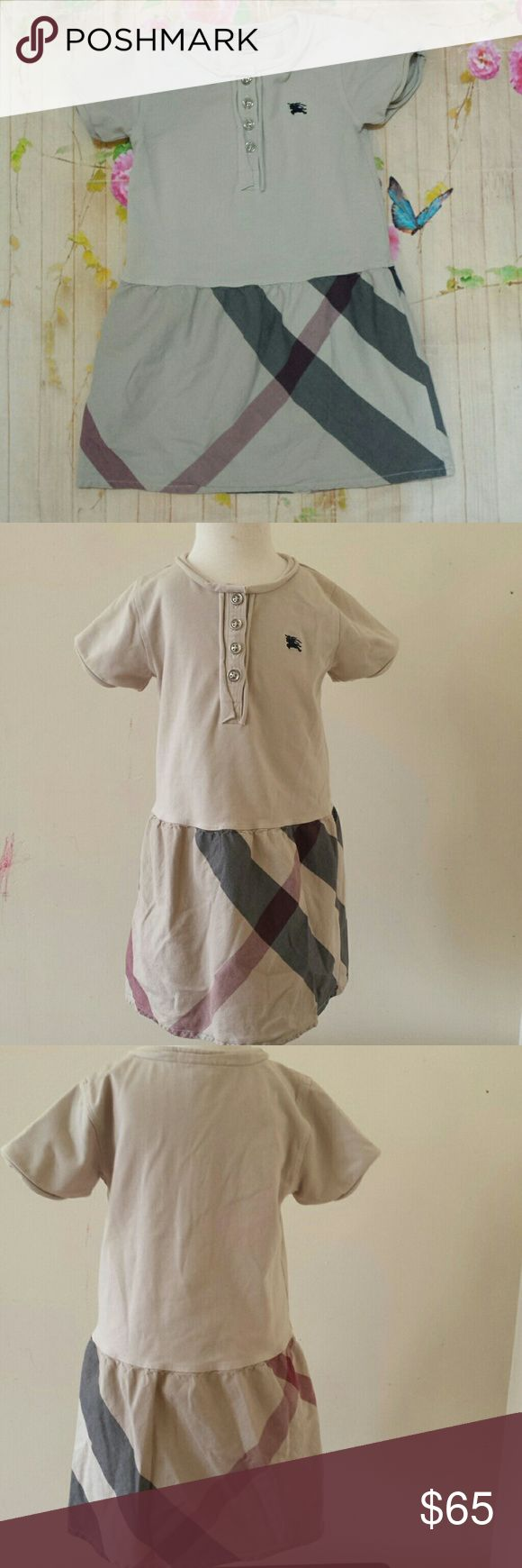 """Classic Burberry Tshirt dress size 2 toddler girl Up for grabs: Cute, classic Burberry t-shirt dress size 2. Light tan / cream color to. Classic check skirt.   Top is 96% cotton, 4% elastane. Skirt is 100% cotton.   10"""" wide, 18"""" long. 4 buttons. short sleeves. c Collar and cuff knit is curling inwards from normal use.  Gently used with no unusual wear.  Smoke-free pet-free home.  Combine items and save on shipping!  contact me with any questions. Burberry Dresses"""
