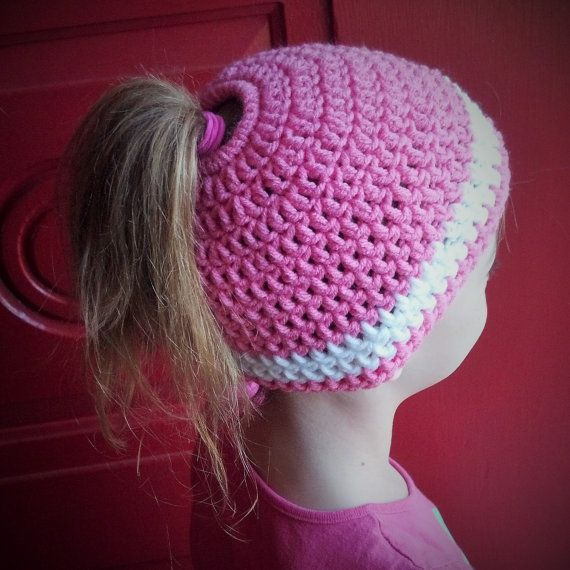 Do you know a gal who loves her ponytails all year round? This hat will be perfect for her! Keeps her hair in place and her head warm too. My little girl loves hers! This hat is crocheted by me with super soft yarn and had a 1 1/2 inch opening in the top for her ponytail. The opening has an elastic band inside so it can stretch to fit buns and larger ponytails as well. You pick the colors you desire! Just type in the notes to seller area upon checkout what colors you would like for the hat…