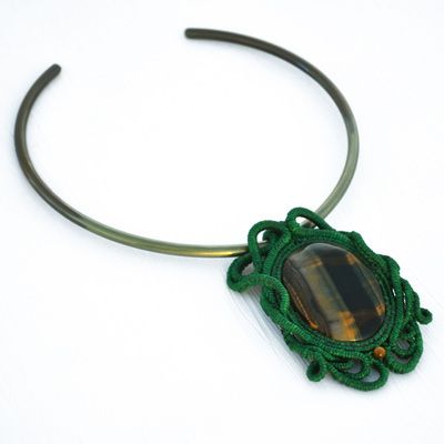 Tiger eye gemstone and green macrame, turns into bright yellow under a black light