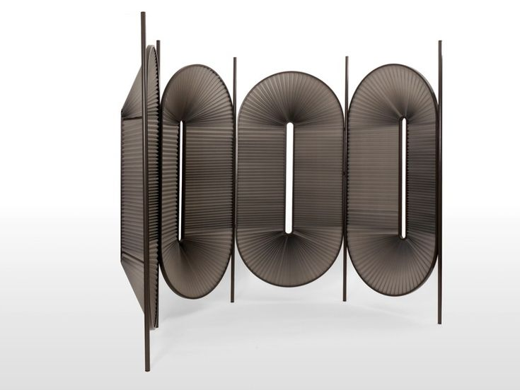 the room divider is made of powder-coated steel and pleated fabric, with an added metropolitan touch.