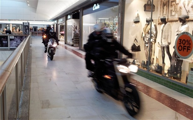 James Bond-style raid as axe-wielding bikers storm shopping centre - Telegraph