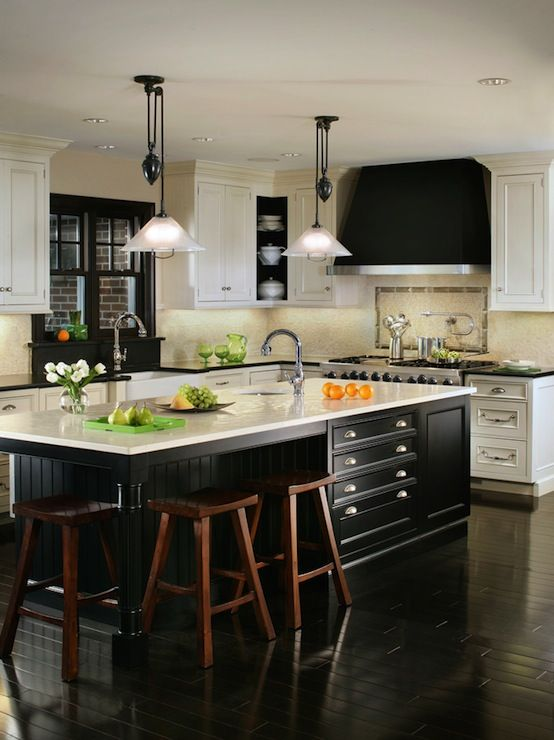 Canterbury Design - black and white kitchen I like the use of black in an all white kitchen.