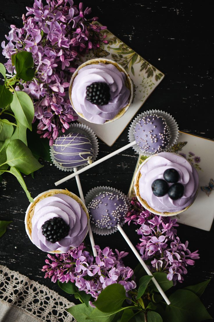 Liliac cupcakes with blueberries  blackberries and lavender chocolate cake pops