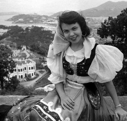 A woman in traditional Portuguese costume, Macau, 1940s.