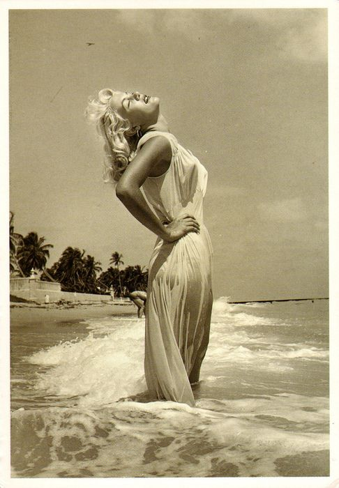 This evocative Greek goddess image is frequently thought to be Marilyn. It is Sandy Fulton, photographed by the famed Bunny Yeager and appears in the book Bikini Girls Of The 1950s. Not Marilyn Monroe