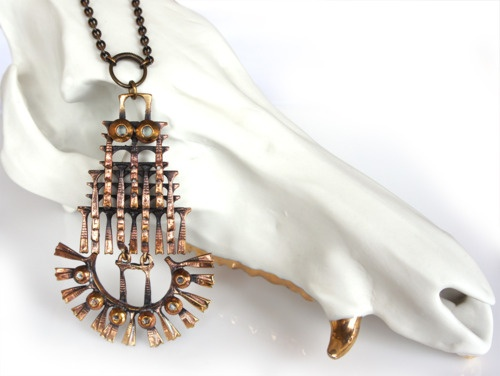 Huge Kinetic Pendant by Pentti Sarpaneva. Ceramic and gold wild boar skull by Christine Facella of Beetle and Flor.