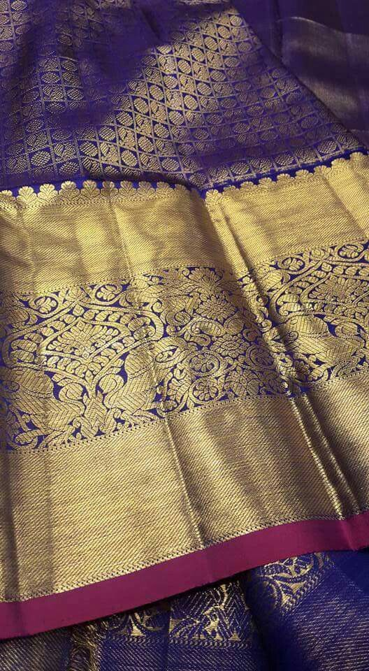 Kanjeevaram silk saree with big zari border. South Indian fashion.