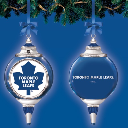 Let your holiday decor reflect your love of hockey and the Toronto Maple Leafs® with our officially licensed ornaments sporting the authentic logos of your favourite team. Each lustrous porcelain ornament gleams with genuine platinum accents, and features familiar team logos along with the NHL® logo. Metal topper, with coordinating hanging ribbon. Includes a velvet pouch for safekeeping.