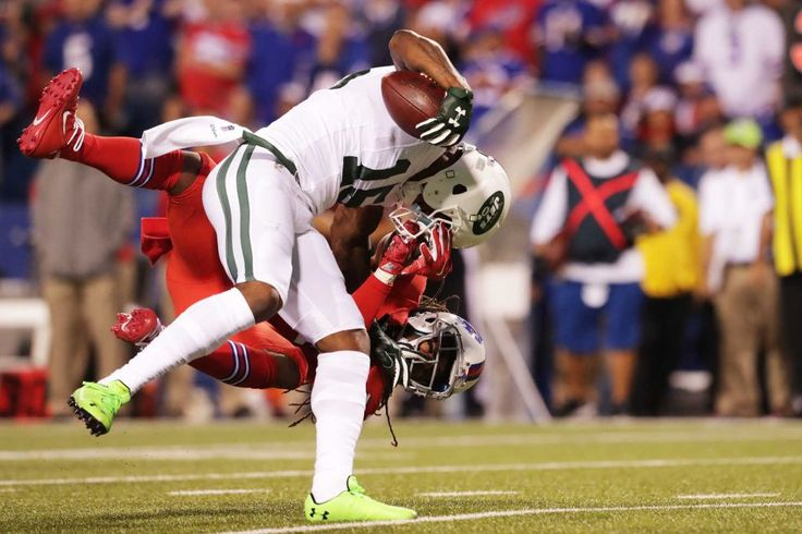 Brandon Marshall of the New York Jets is tackled by Stephon Gilmore of the Buffalo Bills resulting in a knee injury to Marshall during the first half at New Era Field on Thursday, Sept. 15, 2016, in Orchard Park, N.Y.
