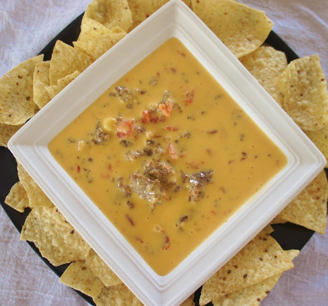 Velveeta/Rotel/Sausage dip  Makes 10-12 servings 1 (32 oz) box of Velveeta cheese, cut into cubes  1 (14 oz) can Rotel diced tomatoes with green chiles  1 lb ground sausage (mild or hot, however you like it)