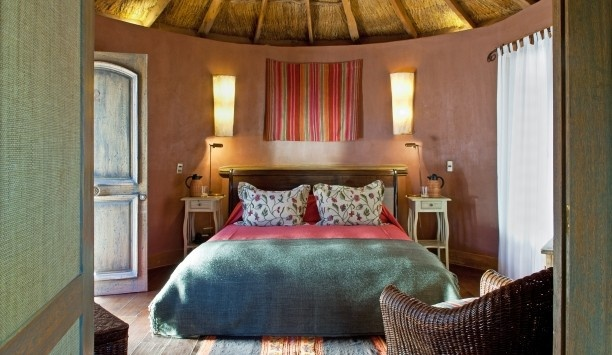 Awasi: Pitched, thatch-roof Round Rooms are done up in earthy colors and local materials.