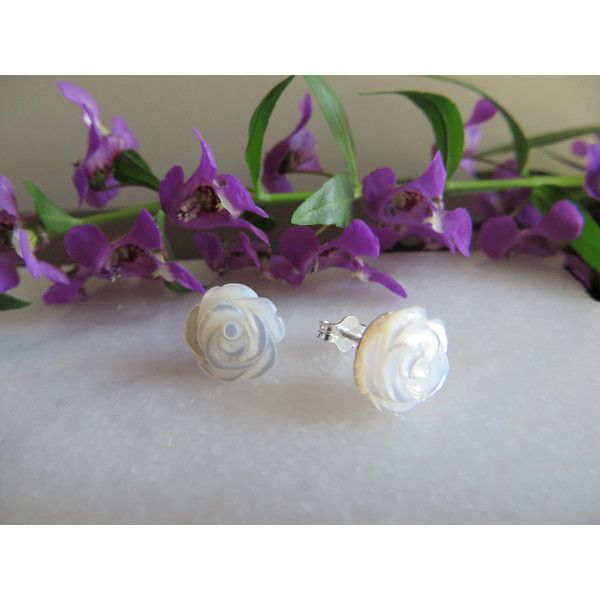 Mother of pearl hand carved flower earrings, Flower studs, Sterling... (€20) ❤ liked on Polyvore featuring jewelry, earrings, sterling silver stud earrings, sterling silver flower stud earrings, wrap earrings, beaded jewelry and mother of pearl flower earrings