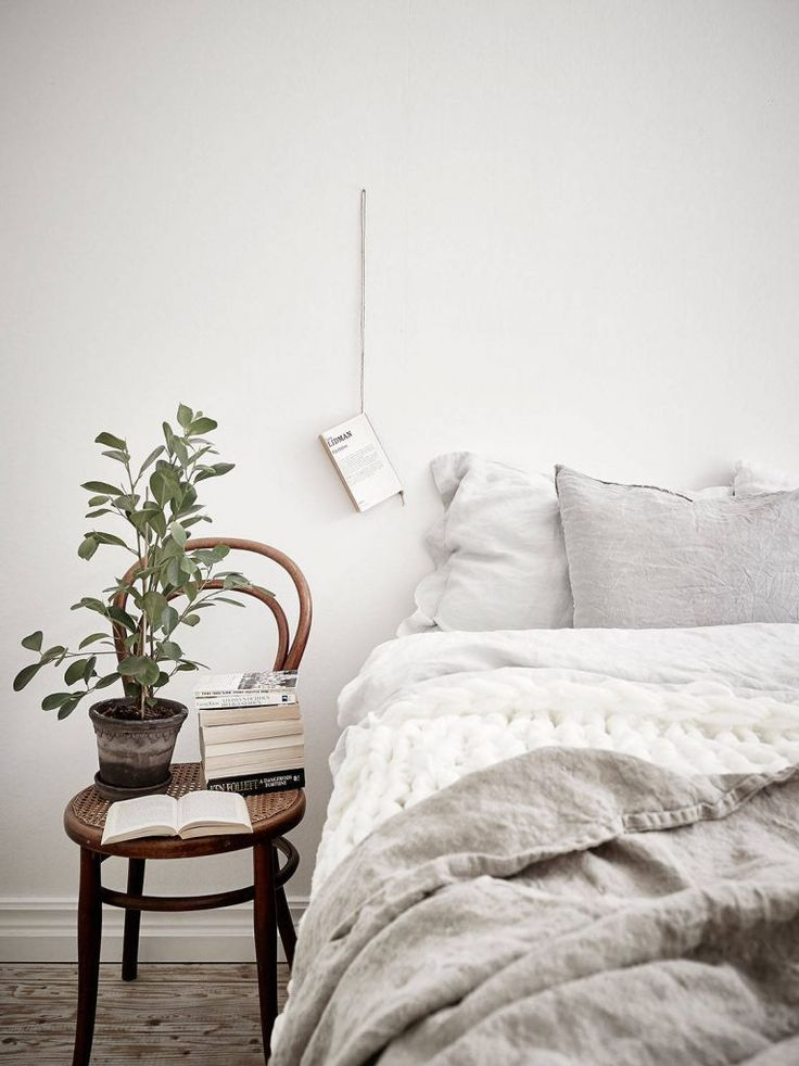 Beautiful linen textures for a bedroom and that book holder is so simple but stunning
