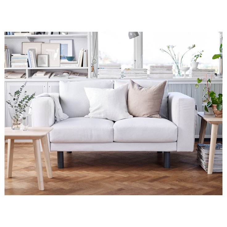 Sofa Beds A light living room with a white two seat sofa with grey legs