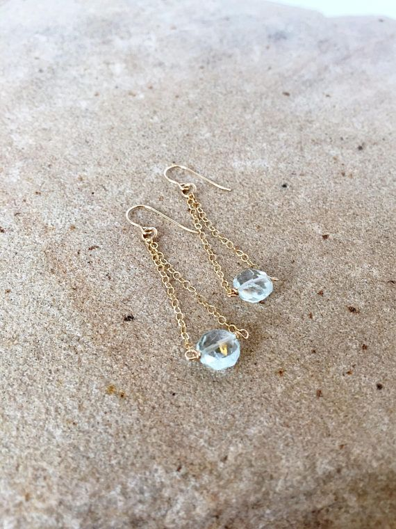 These Aquamarine Earrings feature the March Birthstone of Aquamarine in a dainty design that truly showcases the sparkling pale blue gemstones. The simple, delicate 14k gold filled chain allows the the faceted Aquamarines of icy blue to sparkle and shine. These beauties will make you