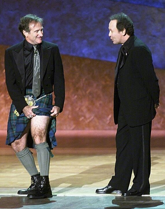 Robin Williams showing Billy Crystal a scandalous amount of leg.