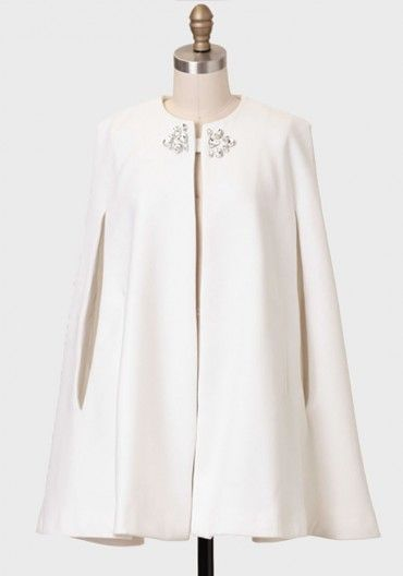 A glamorous winter white cape to be worn over your cocktail dress. @Michael Ellis ahhhhhhh