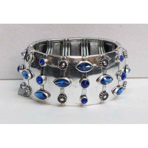 Bracelet élastique de couleur argent serti de cristaux bleus.   Aussi disponible en couleur  anthracite avec cristaux rouges.