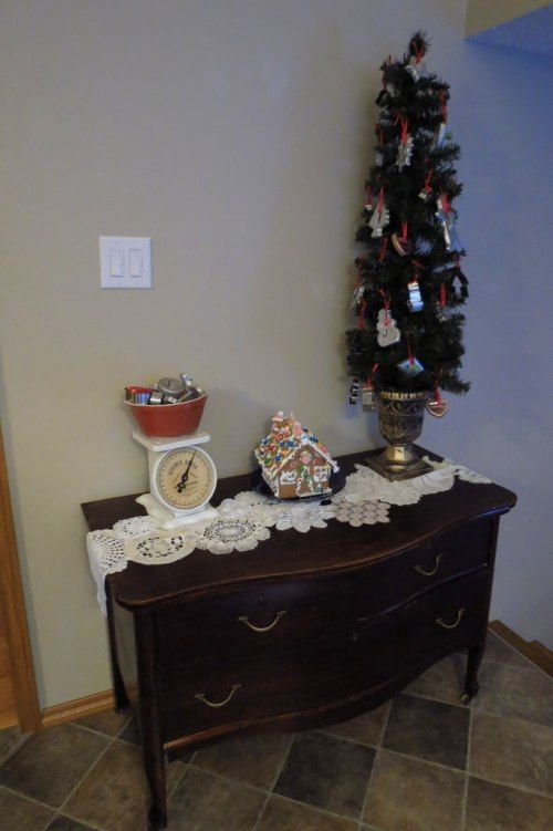 Christmas Kitchen tree.  Buffet, credenza in the kitchen.  Cookie cutter tree and doily runner.