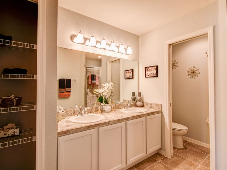 Gallery Website Whites and cream colors give this master bathroom a polished and modern ambiance DreamHome