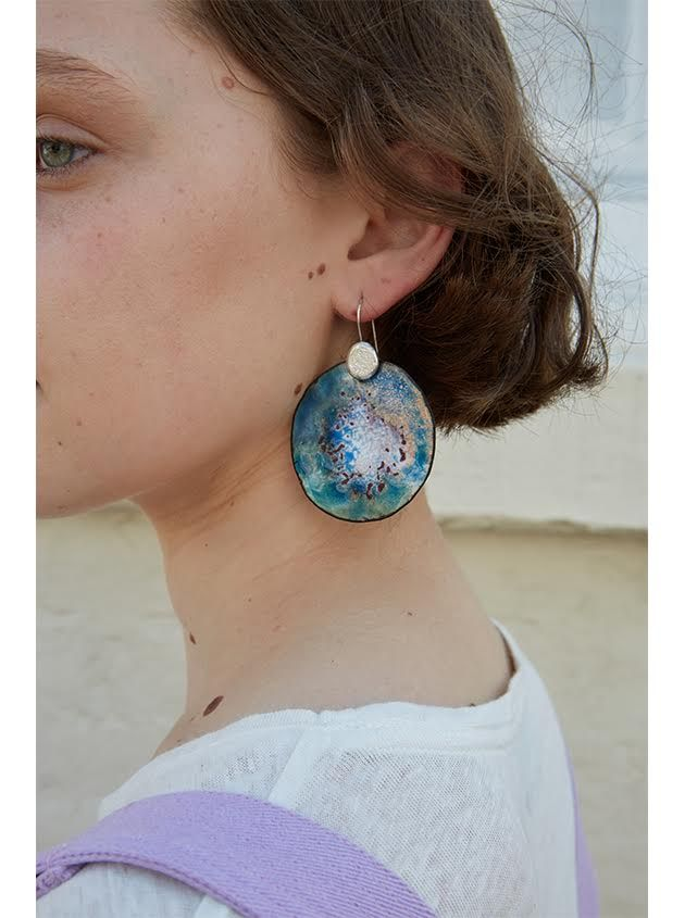 Stormy Imaginary Planet earrings make a huge statement for any occasion. These enamel earrings are designed and handmade by jeweller and artist Ada Hodgson. Available online at brieleon.com and adahodgson.com