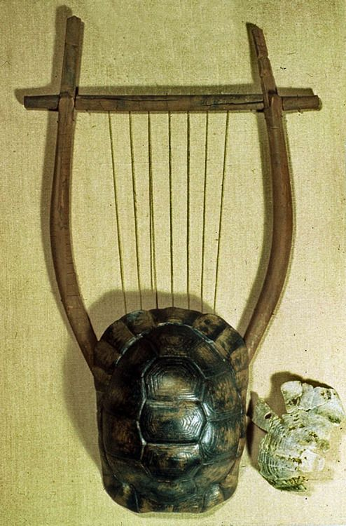 Lyre restored from remains.Have been found in Athens Greece, and probably 5th or 4th century BC. The lyre was a stringed instrument plucked with the fingers or a plectrum. The tortoise shell served as a sound box. The strings stretched over a bridge and were held in tension by a cross-piece supported on two projecting arms. Elgin Collection,British Museum. Λύρα αποκατεστημένη από υπολείμματα Έχει βρεθεί στην Αθήνα, και είναι πιθανόν του 5ου ή 4ου αιώνα π.Χ.. Η λύρα ήταν ένα ...