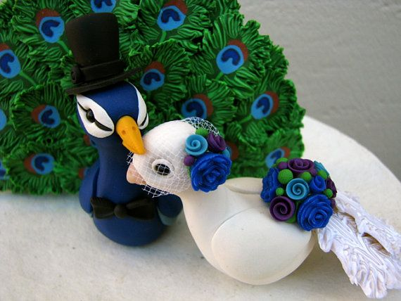 This adorable peacock and peahen couple is made to order. They are made from non-toxic polymer clay. Which means, they would be great on top of a very special and tasty cake! They also LOVE sitting on shelves enjoying each others company. *******Have a tight budget, but want us to create your topper? Dont hesitate to contact me. I do not give any other shop permission to copy my sculptures or their likeness.*******  So many details to enjoy year after year :)  This listing includes: Bride…