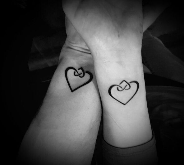 Adoption symbol tattoos on mother and adopted daughter