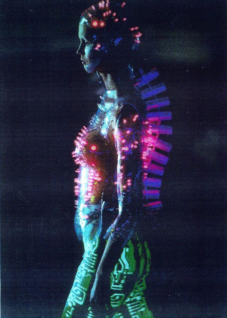Programmed LED cyborgs by Kees van der Graaf for Alexander McQueen catwalk at Givenchy Paris . Fall 1999  .Flourescent circuitry legwear .