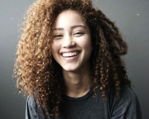 girl tan skin curly sandy hair brown eyes